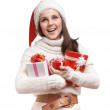 The smiling girl is holding the presents - Stock Photo