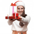 The smiling girl is giving the presents — Stock Photo