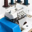 Stock Photo: Overlock with seasoned cloth