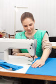 Young seamstress at work — Stock Photo