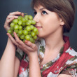 Girl is wanting green grapes — Stock Photo #19904243