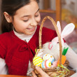 Girl with a basket of Easter eggs — Stock Photo #22012737
