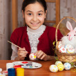 beautiful girl colored easter eggs — Stock Photo