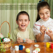 Brother and sister painted Easter eggs — Stock Photo #22015767