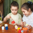 Brother and sister painted Easter eggs — Stock Photo