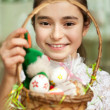 Girl with a basket of Easter eggs — Stock Photo