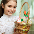 Girl with a basket of Easter eggs — Stok fotoğraf