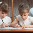 Children draw in a notebook — Stock Photo