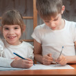 Stock Photo: Children draw in a notebook