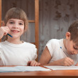 Stock Photo: Children do their homework
