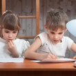 Foto Stock: Cute kids do their homework