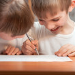Funny boy draws a pen on paper — Stok fotoğraf