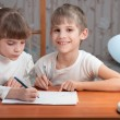 Foto Stock: Children drawing on paper