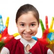 Little girl with her hands painted — Stock Photo #22328997