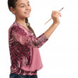 Cute girl draws a brush in space — Stock Photo