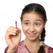 Skeptical girl draws a brush in space — Stock Photo #22329345