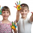 图库照片: Kids show their hands soiled in a paint