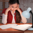 Girl was very tired to do homework — Stock Photo