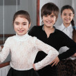 Children standing near a ballet barre — Stock Photo