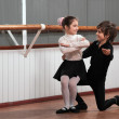 Children dancing in a ballet barre - Stock Photo