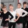 Group of children standing at ballet barre — Stock Photo #22331365