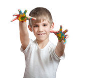 Boy shows his hand smeared in paint — Stock Photo