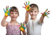 Kids show their hands soiled in a paint — Stock Photo