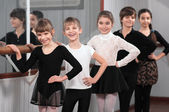 Group of children standing at ballet barre — Stock Photo