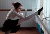 Girl ballet dancer practicing on the barre — Stock Photo