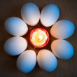 Eggs are laid around the candle — Stock Photo
