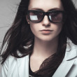 Businesswoman staring through sunglasses — Stock Photo