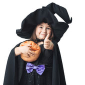 Little witch showing thumbs up — Stock Photo