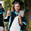 University graduate with a diploma — Stock Photo #32966307