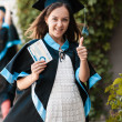 Stock Photo: University graduate with a diploma