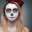 Girl with a skull face makeup — Stock Photo