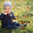 Little boy sitting on the grass — Stock Photo
