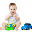 Baby playing with toy cars — Stock Photo #35015991