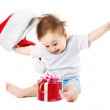 Happy baby gifts at Christmas by throwing his hat — Stock Photo