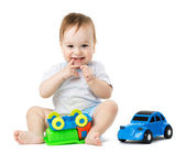 Baby playing with toy cars — Stock Photo