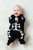 Baby dressed skeleton — Stock Photo