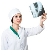 Girl traumatologist considers radiograph — Stock Photo