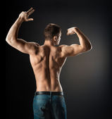Bodybuilder showing muscles in the arms — Stock Photo
