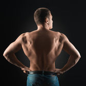 Bodybuilder shows dorsi — Stock Photo