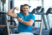 Gay guy shows bulging muscles — Stock Photo