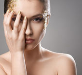 Pretty girl with golden make-up art — Stock Photo