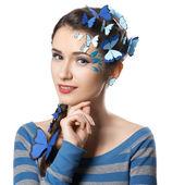 Girl with art make-up blue butterflies — Stock Photo