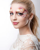The beautiful blonde with artistic make-up — Zdjęcie stockowe