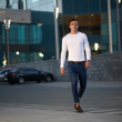 Fashionable guy is the evening city — Stock Photo #47711393