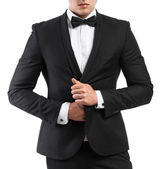 Business man in a suit straightens his jacket — Stock Photo