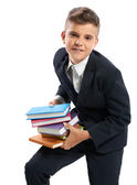 Student holding heavy books — Stock Photo